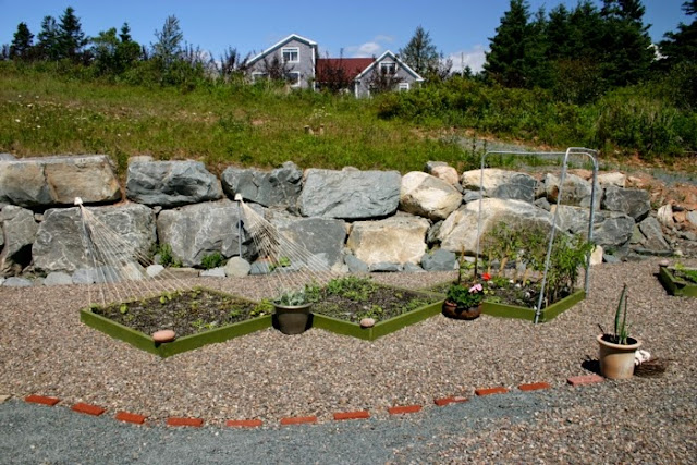 four square gardening and rock landscaping