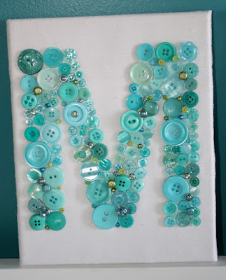 http://www.modernlymorgan.com/2011/12/button-letter-nursery-artwork-tutorial.html