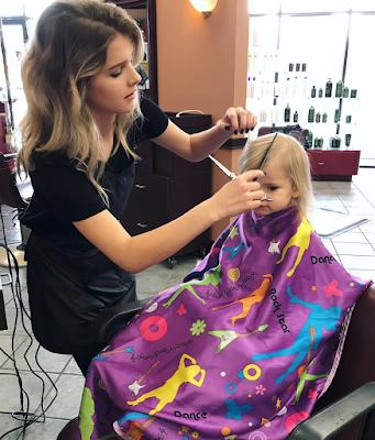 Josie cuts Kaci Lynn Bates' hair