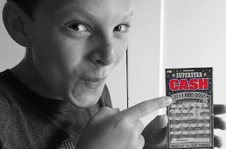 Kid Holding Lottery Ticket