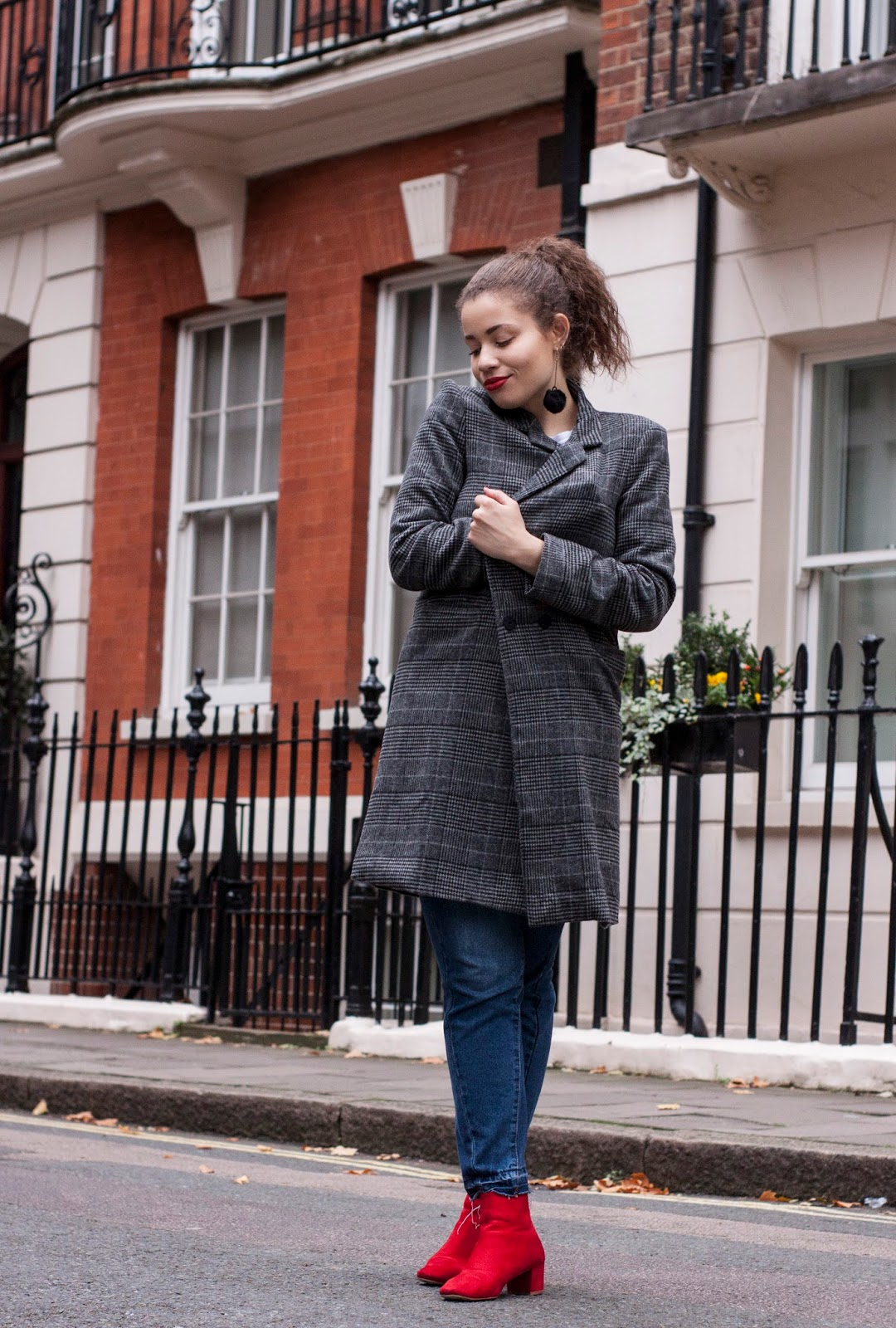 Eboni wearing grey check coat from Pretty Little Thing