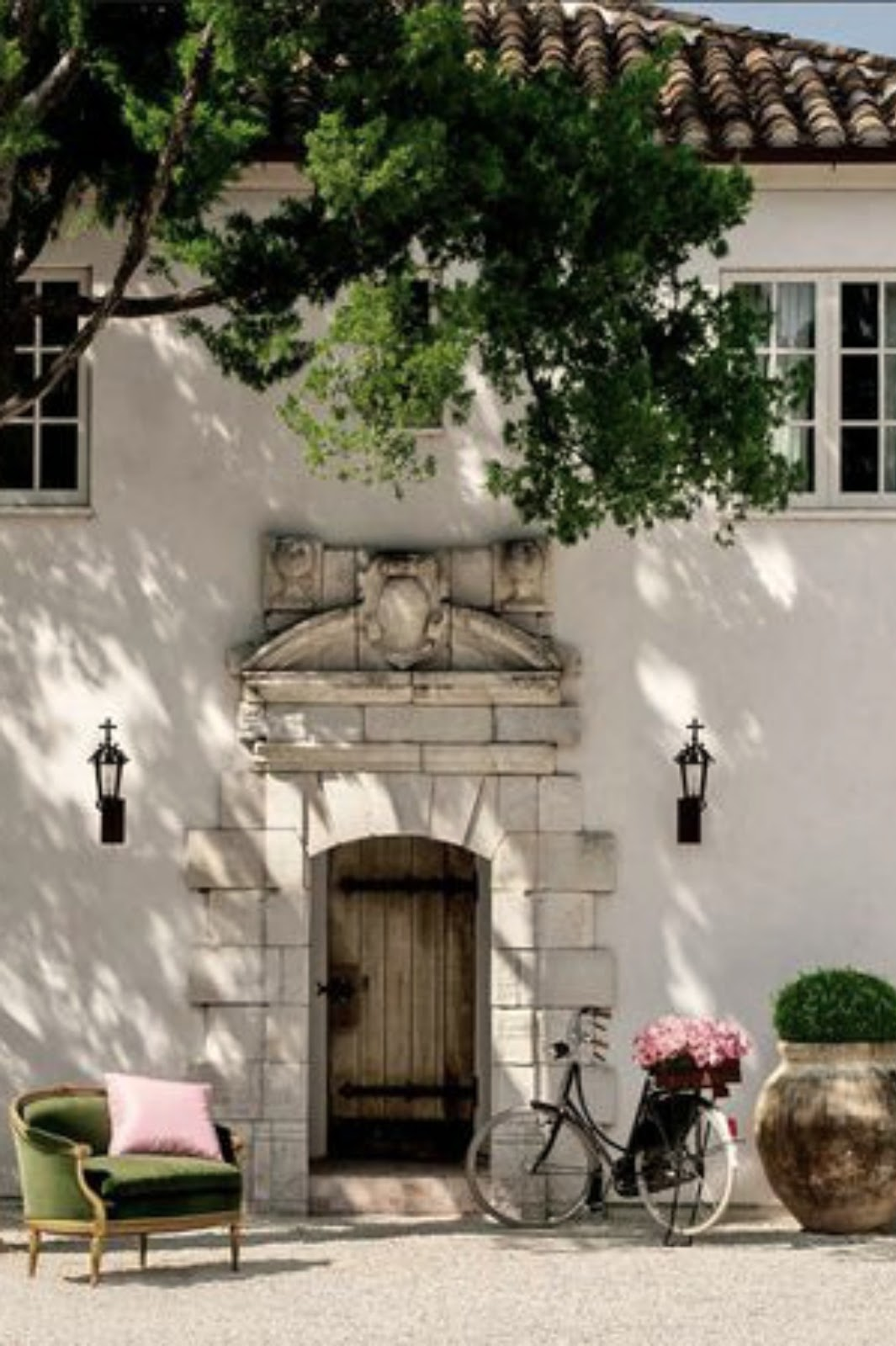 French chateau with limestone and lanterns - found on Hello Lovely Studio