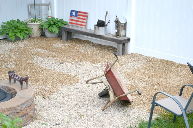 Tipped pea gravel and bench in fire pit area