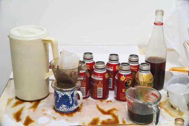 Cold-brew coffee ingredients on a messy table