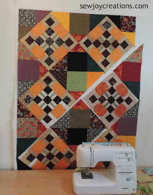 half of middle section of pumpkin block quilt sewn together