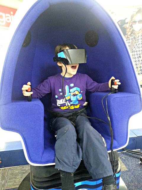 Boy taking part in a 9D virtual reality experience