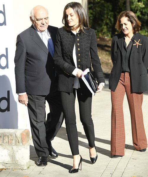 Queen Letizia wore Zara Velvet Military Jacket. Queen Letizia carried Hugo Boss fanila clutch. pearl earrings