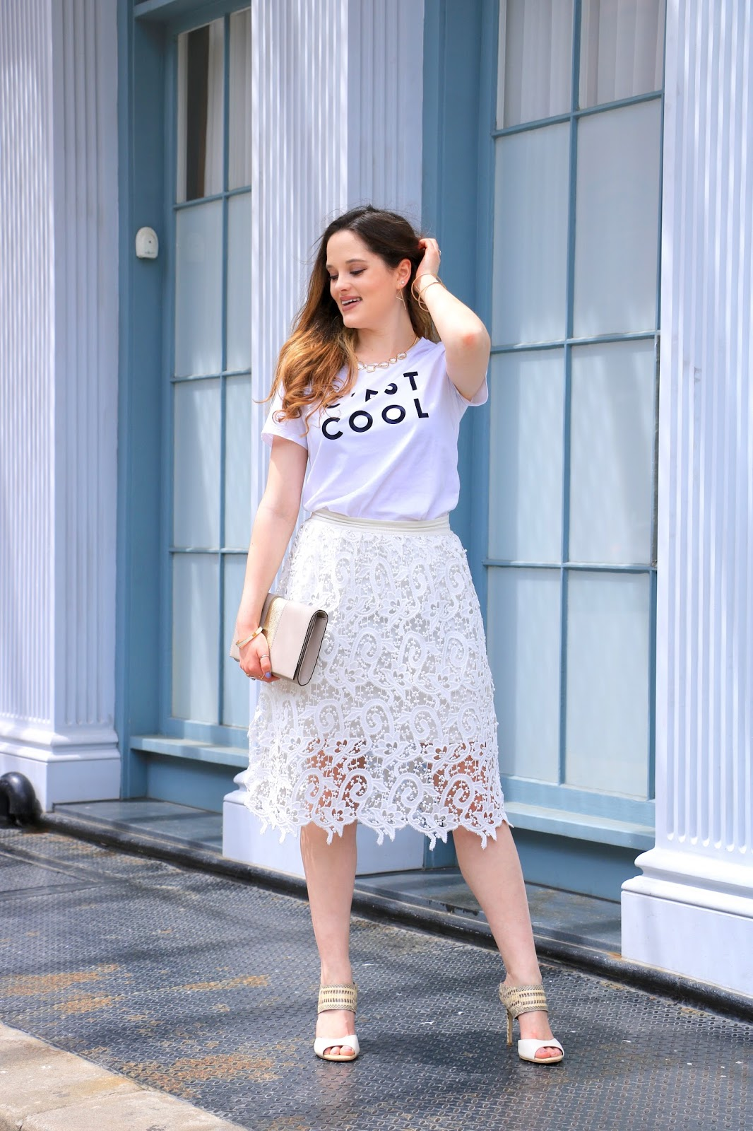 nyc fashion blogger Kathleen Harper wearing a graphic tee with a lace pencil skirt