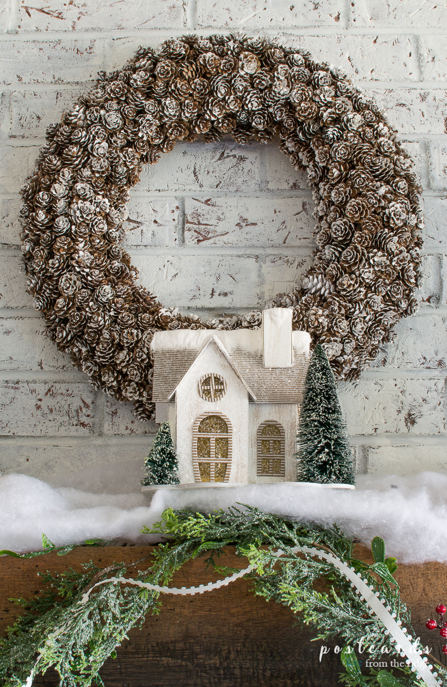 pine cone wreath and snow covered paper house