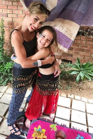 Melanie Jacobs hugging girl with Jasmine-themed make-up