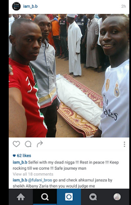 Chai!! Young Men Pose For Selfie With Their Dead Friend During His Funeral  (See Photo)