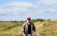 Presidential contender Donald Trump gestures to the media on the 17th fairway on the first day of the Women's British Open golf championship on the Turnberry golf course in Turnberry, Scotland, Thursday, July 30, 2015. (Photo Credit: AP/Scott Heppell) Click to Enlarge.