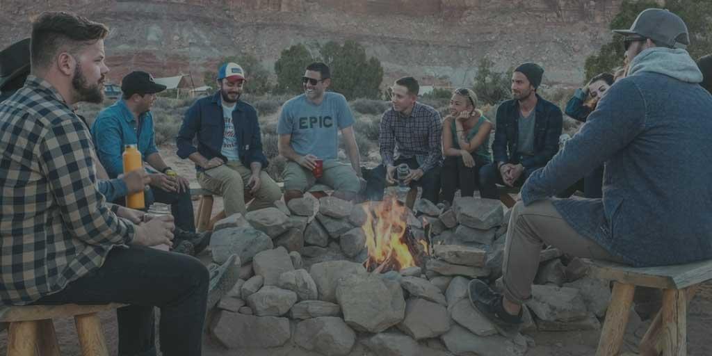 Friends sitting around the campfire