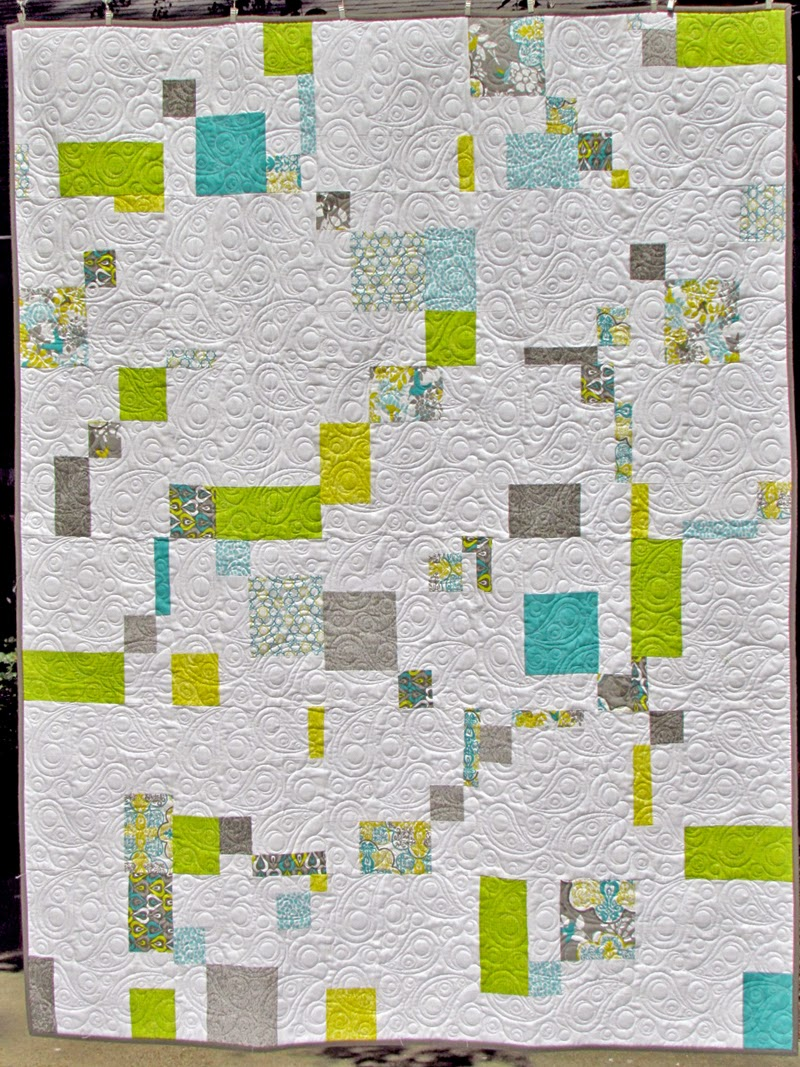A modern double disappearing 9 patch quilt top by Marty Mason