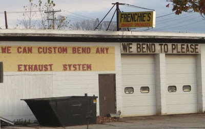 Muffler shop with sign that says We Bend to Please