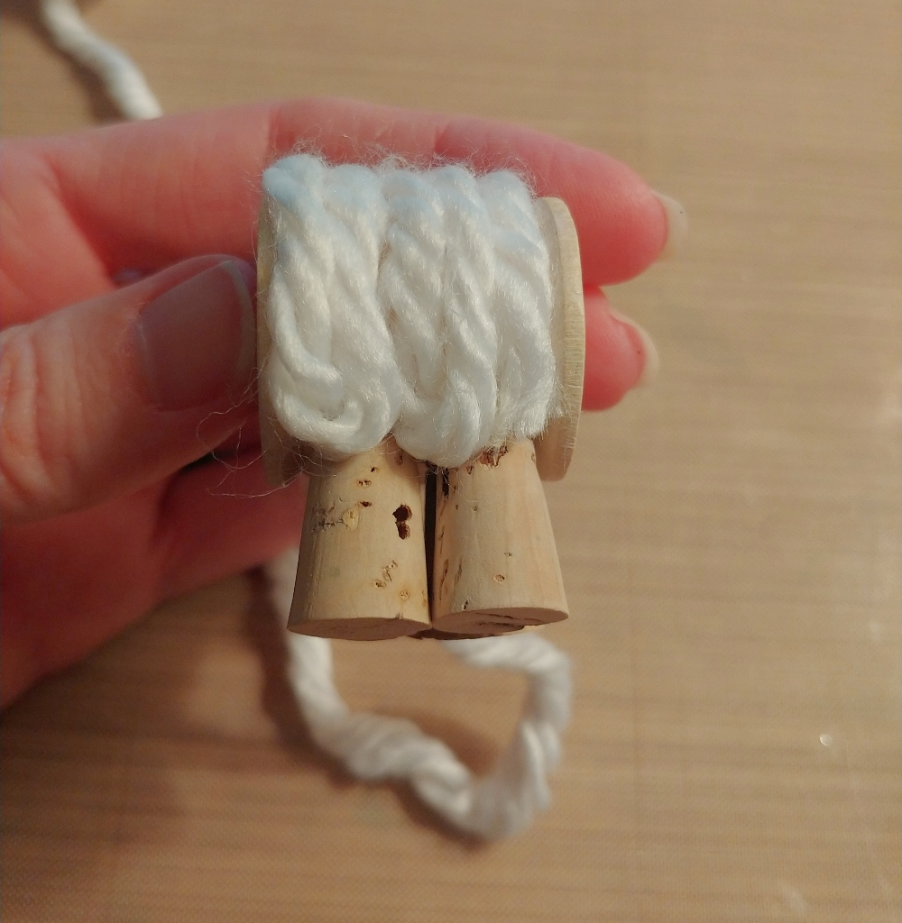 glue the yarn to the spool