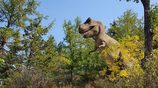 An inaccurate rendering of a T-Rex meandering through the forest...