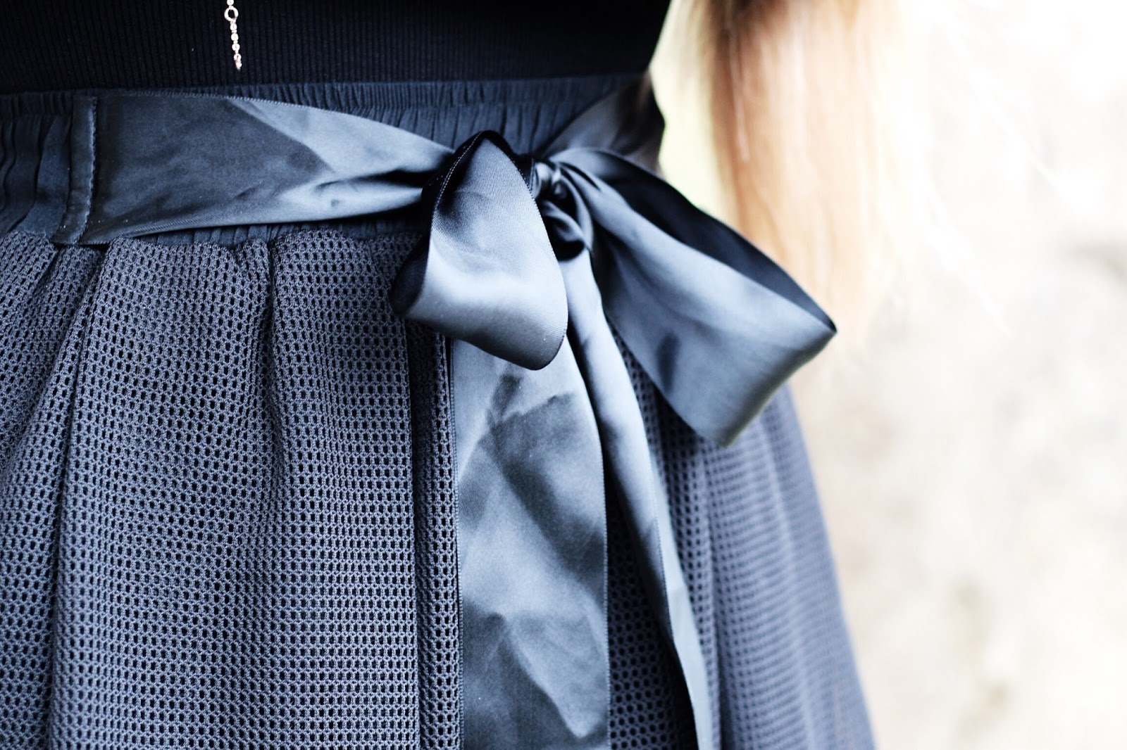 Satin ribbon bow and black mesh skirt