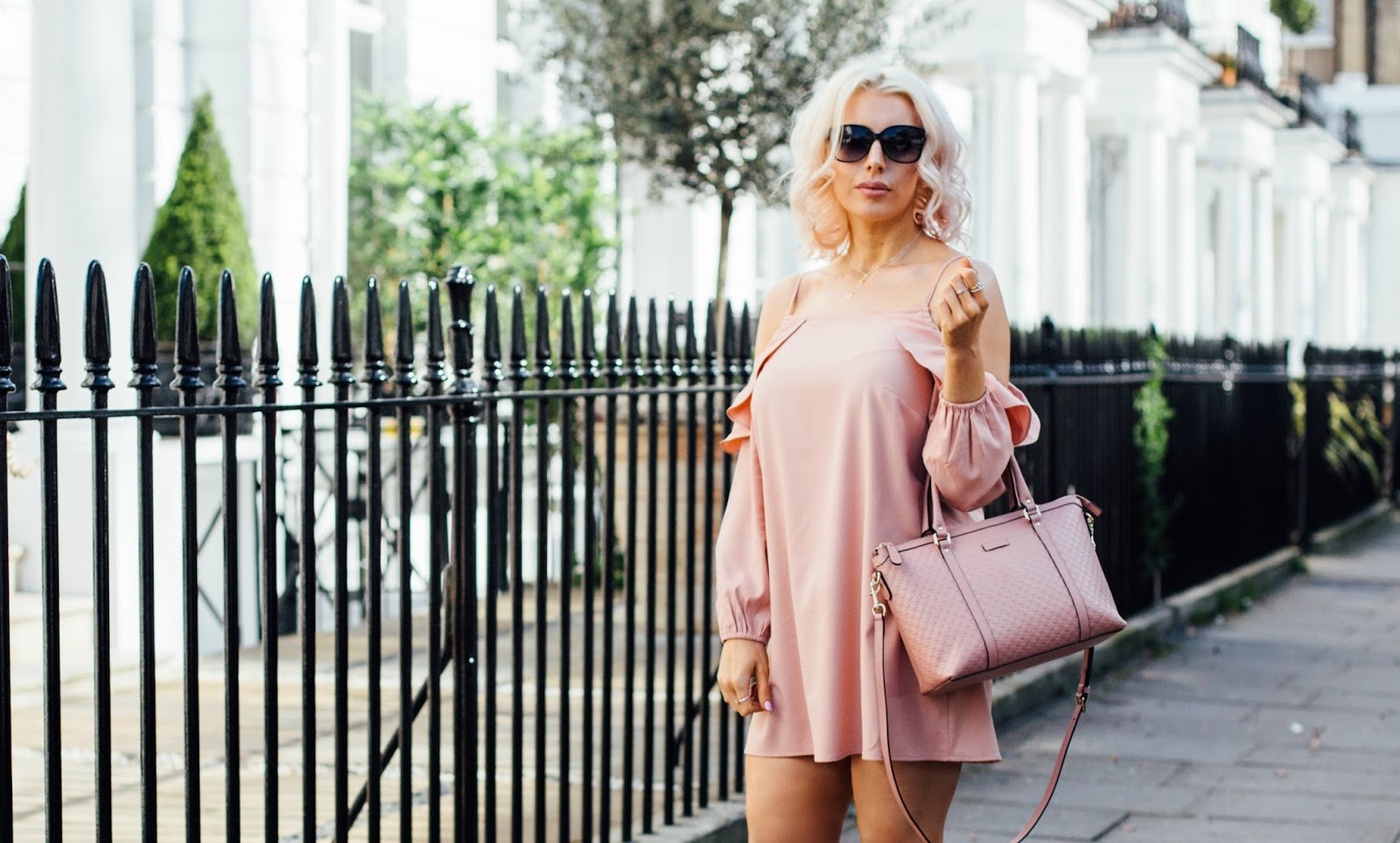 pink cold shoulder dress and pink gucci handbag perfect for spring