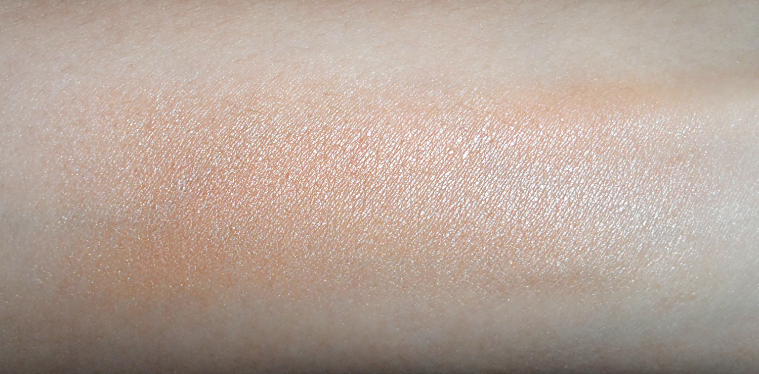 a close-up picture of a brozning makeup powder swatch on the hand