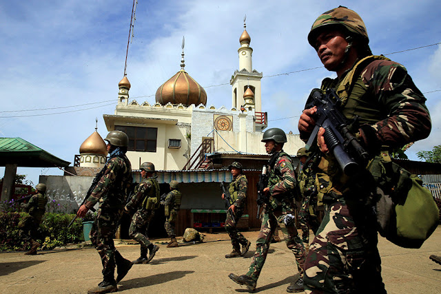 "UPDATE: June 4, 2017 Defense Sec. Delfin Lorenzana has confirmed that eight of the more than 100 ISIS fighters in Marawi City are foreign nationals. Lorenzana said they include two Saudi nationals, two Malaysians, two Indonesians, one Yemeni and one from Chechnya.  Lorenzana further said, Presidential Adviser for Mindanao Affairs Abdul Khayr Alonto have the names and identities of the foreign nationals who are believed to be members of the international terrorist group ISIS. The names will not be published until the operations in Marawi is over.  Most of the slain fighters in Marawi, members of the Maute terror group are from Sulu, Basilan, Zamboanga area.  UPDATE: June 1, 2017 At least eight foreign terrorists have been killed in besieged Marawi City as residents reported seeing ""foreign-looking"" fighters joining gunfights against state forces, Defense Secretary Delfin Lorenzana said Thursday. Lorenzana said the military has so far identified 2 Malaysians, 2 Saudis, 2 Indonesians, a Yemeni, and a Chechen as among those killed in the siege, which started Tuesday last week. ""The report we got from the civilians from Marawi is they saw a lot of foreign-looking fighters,"" the defense chief said. Lorenzana said 95 terrorists have been killed in the clashes, with 33 already identified. The defense chief said foreigners who were fighting alongside local terror groups Maute and Abu Sayyaf could have entered the country through the southern backdoor. A Reuters report quoted a Philippine intelligence source as saying that of the 400-500 marauding fighters who overran Marawi City, as many as 40 had recently come from overseas, including from countries in the Middle East. The source said they included Indonesians, Malaysians, at least one Pakistani, a Saudi, a Chechen, a Yemeni, an Indian, a Moroccan and one man with a Turkish passport.  Original Post: The Philippine military chief says three Malaysians, an Indonesian, and possibly Arab fighters have been killed in a southern city that armed groups planned to burn entirely in an audacious plot to project the lethal influence of ISIL. At a news briefing, Brigadier-General Restituto Padilla said ""There are... Malaysians, Singaporeans... We are continuously verifying that there have been a number of them who have been killed."" Meanwhile, General Eduardo Año told The Associated Press in an interview that the military has made advances in containing the week-long siege of Marawi city. He said a top Filipino fighter is believed to have been killed and the leader of the attack was wounded.  Año said the group plotted to set Marawi ablaze and kill as many Christians in nearby Iligan city on Ramadan to mimic the violence seen by the world in Syria and Iraq. The army insists the drawn-out fight is not a true sign of the group's strength, and the military has held back to spare civilians' lives. ""They are weak,"" Año said of the gunmen, speaking at a hospital where wounded soldiers were being treated. ""It's just a matter of time for us to clear them from all their hiding places."" He said the military had cleared 70 percent of the city by doing house-to-house operation. The remaining fighters were reportedly isolated. Still, the fighters have turned out to be remarkably well-armed and resilient.  Attack helicopters were streaking low over Marawi on Monday, firing rockets at hideouts, as heavily armed soldiers went house to house. The gunmen have held the Philippine army at bay, burning buildings, taking at least a dozen hostages and sending tens of thousands of residents fleeing.  Año said Tuesday that the commander, Isnilon Hapilon, is still hiding somewhere in the city. Authorities were working to confirm that another leader had been killed.  President Rodrigo Duterte declared martial law in the south through mid-July after the fighters went on a deadly rampage in Marawi last week following an unsuccessful military raid to capture Hapilon. In recent years, small armed groups in the Philippines, Indonesia and Malaysia have begun unifying under the banner of Islamic State of Iraq and Syria (ISIS). Jose Calida, the top Philippine prosecutor, said last week that the violence on the large southern island of Mindanao ""is no longer a rebellion of Filipino citizens"". Rohan Gunaratna, a security expert at Singapore's S Rarajatnam School of International Studies, said ISIL and the smaller regional groups are working together to show their strength and declare a Philippine province part of the caliphate that ISIL says it created in the Middle East. He said the fighting in Marawi, along with smaller battles elsewhere in the southern Philippines, may be precursors to declaring a province, which would be ""a huge success for the terrorists"". Analysts have warned that as ISIL is weakened in Syria and Iraq, battered by years of American-led attacks, Mindanao could become a focal point for regional fighters. Civilians trapped in Marawi as battle against ISIL-linked fighters intensifies Southeast Asian fighters fleeing the Middle East ""could look to Mindanao to provide temporary refuge as they work their way home"", said a report late last year by the Jakarta-based Institute for Policy Analysis of Conflict, predicting a high risk of regional violence.  Marawi is regarded as the heartland of the Islamic faith on Mindanao island. Muslim rebels have been waging a separatist rebellion in the south of the predominantly Roman Catholic nation for decades. The largest armed group dropped its secessionist demands in 1996, when it signed an autonomy deal with the Philippine government. Amid continuing poverty and other social ills, restiveness among minority Muslims has continued. Hapilon, an Islamic preacher and former commander of the Abu Sayyaf, pledged allegiance to ISIS in 2014. He now heads an alliance of at least 10 smaller groups, including the Maute.  Acmad Aliponto, a 56-year-old court sheriff who decided not to flee the city, said while the fighters were well-armed, he believes they have little local support, and that the recent violence could turn more people against them.  ""In the end their relatives and everyday people may be the ones who will kill them,"" he said. ""Look at what they did. So many were affected."""