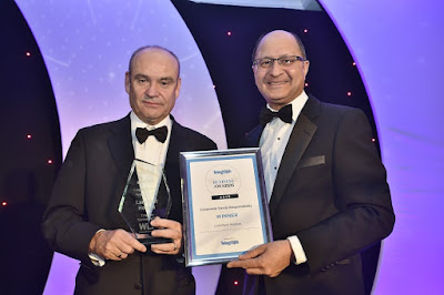 Larkfleet Homes CEO Karl Hick (left) being handed the Peterborough Business Awards trophy by Shailesh Vara MP.