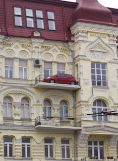 red car on a french chateau balcony