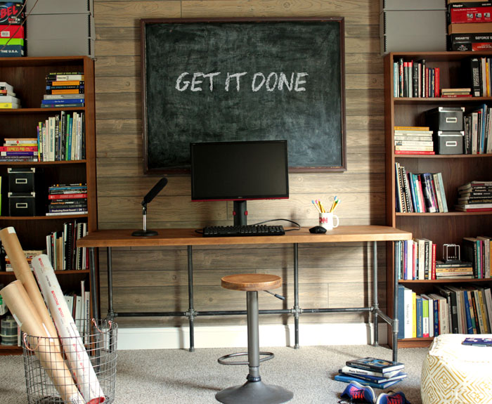basement desk made of pipes - play room with chalkboard and shelves