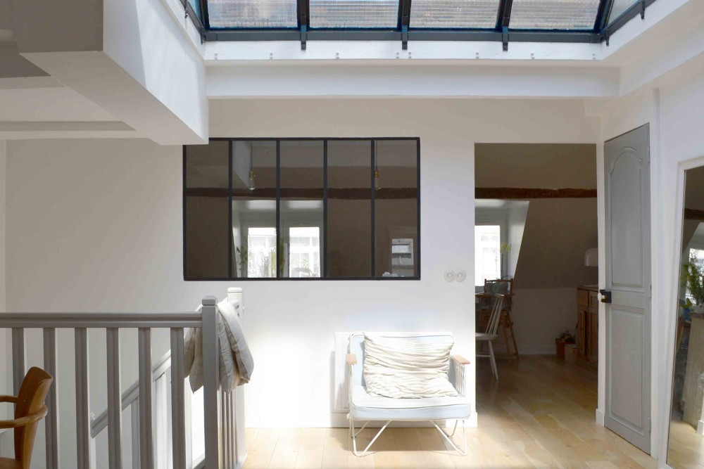 Stair landing with skylight in 1650 Marais Paris home of Lucille Gauthier-Braud