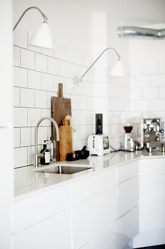 White scandinavian contemporary kitchen. Photo by Sara Landstedt