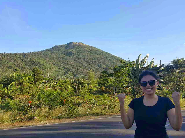 After the Successful Climb! Abbie with Mt. Kalisungan at the background