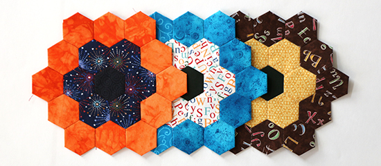 Three Overlapping EPP Hexagon Flower Blocks Straight On