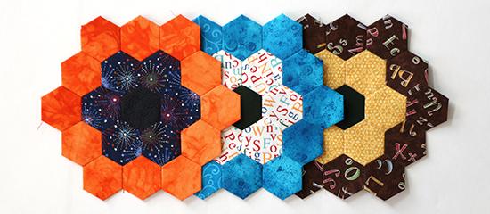 Three Overlapping EPP Hexagon Flower Blocks Straight On