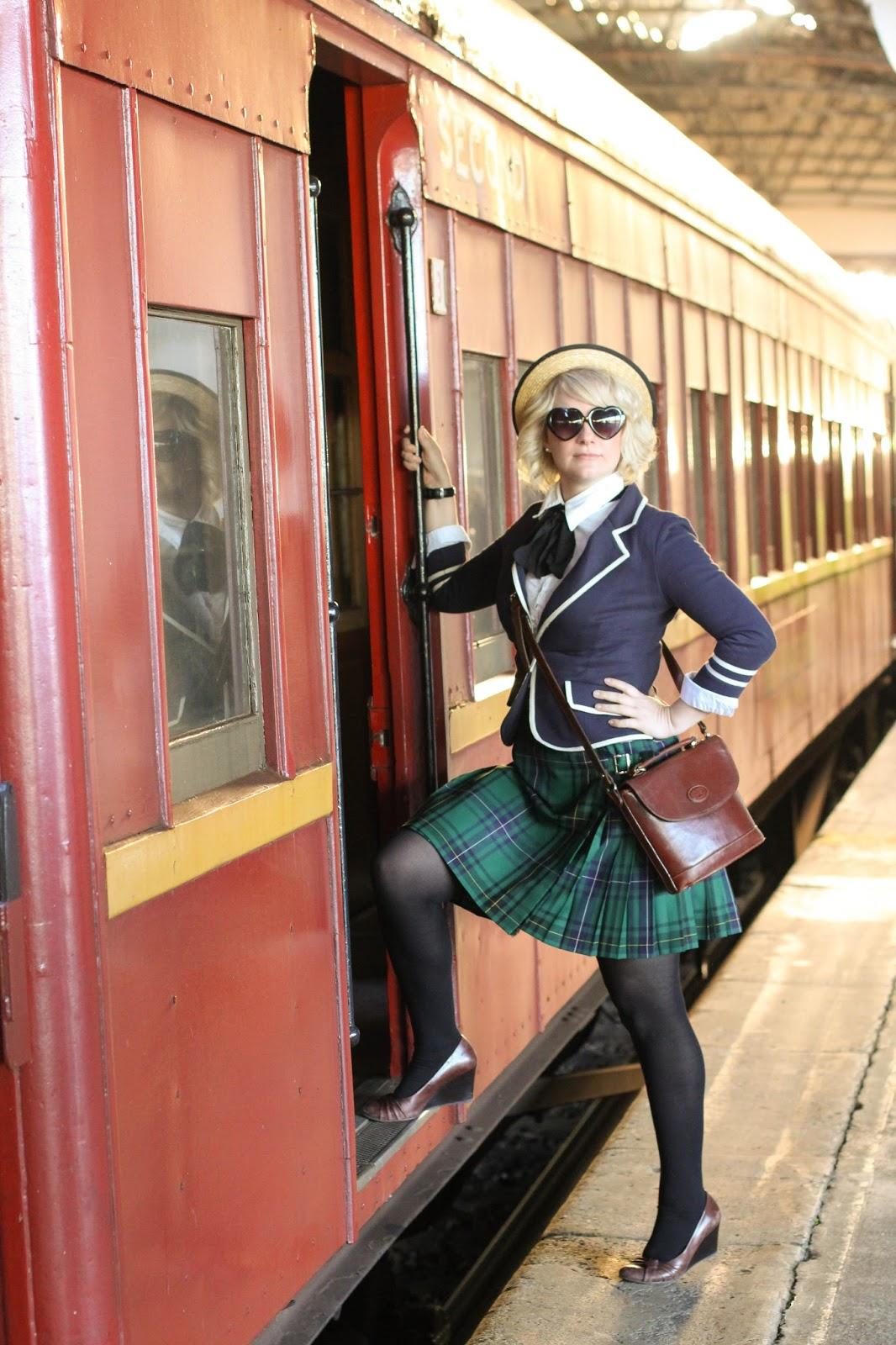 Liana of Finding Femme wears navy Modcloth Academia Ahoy blazer, black necktie, straw boater, green tartan school skirt at Ballarat Train Station for the steam train ride at Ballarat Heritage Weekend.