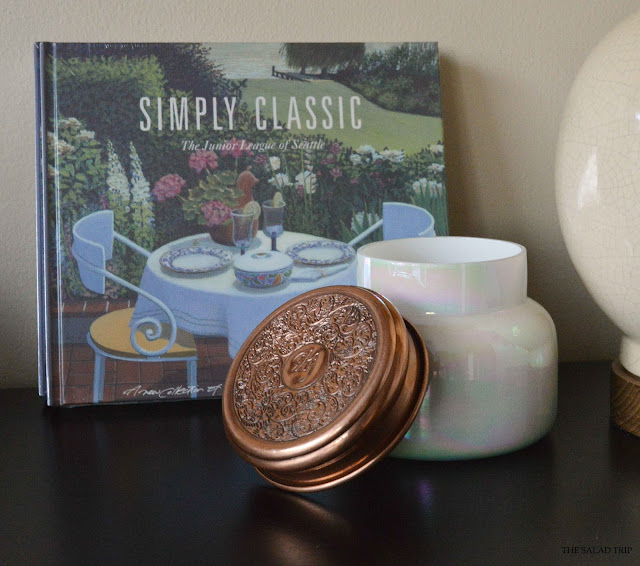 Volcano Candle by Capri Blue next to Simply Classic JLS cookbook