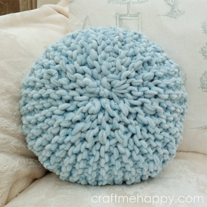 small round knitted pillow