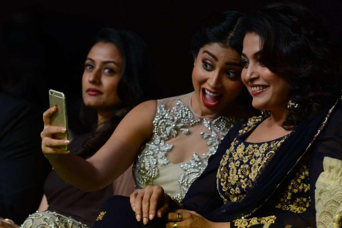 Shriya Saran poses for a selfie with Ramya Krishnan during IIFA Utsavam