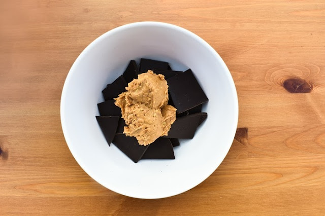 dark chocolate and peanut butter in white bowl