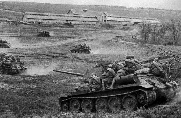 Russian T-34 tanks with infantry are moving up to German positions , near Odessa, Ukraine, 1944.