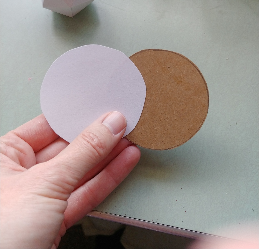 cut out a circle of cardboard and cardstock