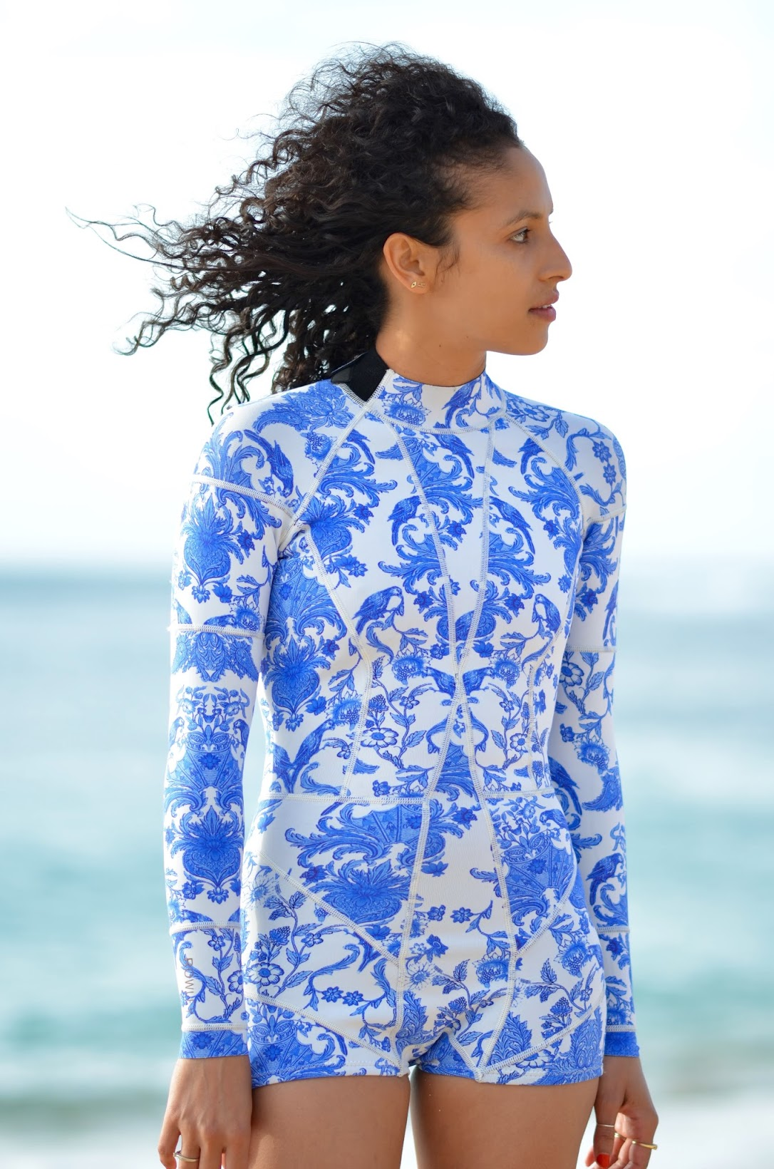 Cynthia Rowley wetsuit, blue ruffle crop top, sunset beach oahu, curly hair
