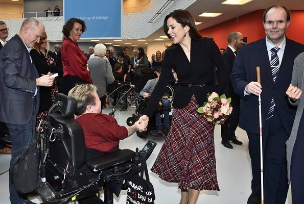 Crown Princess Mary wore Alexander McQueen High waisted boucle tweed midi skirt. The Princess wore a tweed midi skirt by Alexander McQueen