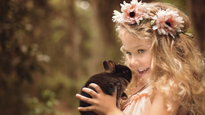 Cute Smiley Girl Baby Is Having Flower Crown On Head And Having Black Rabbit In Hand Hd Cute Wallpaper