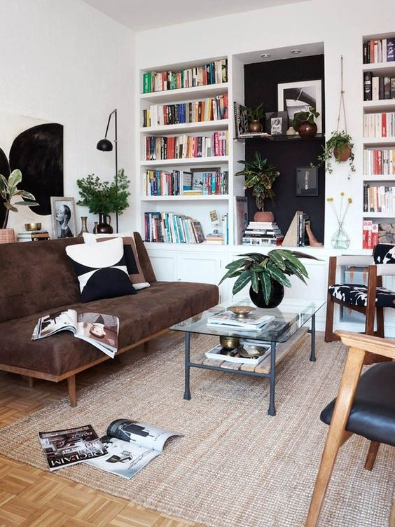 Books, vintage pieces and lots of plants add personality to this rental apartment.