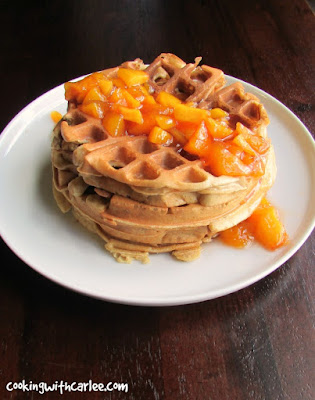 stack of waffles with a generous helping of chunky peach sauce on top