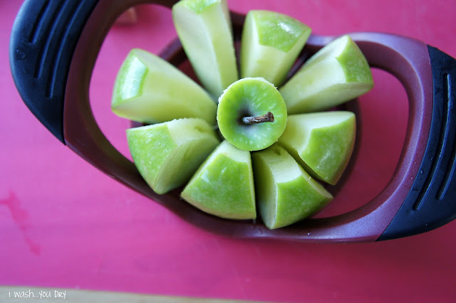 A close up fo a sliced apple on a cutting board.