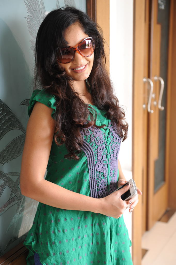 Madhavi latha sexy in green top