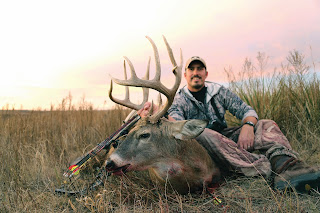 giant buck killed with heads up decoy