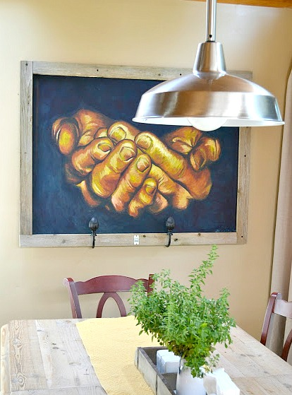 Reclaimed wooden framed painting over a farmhouse table