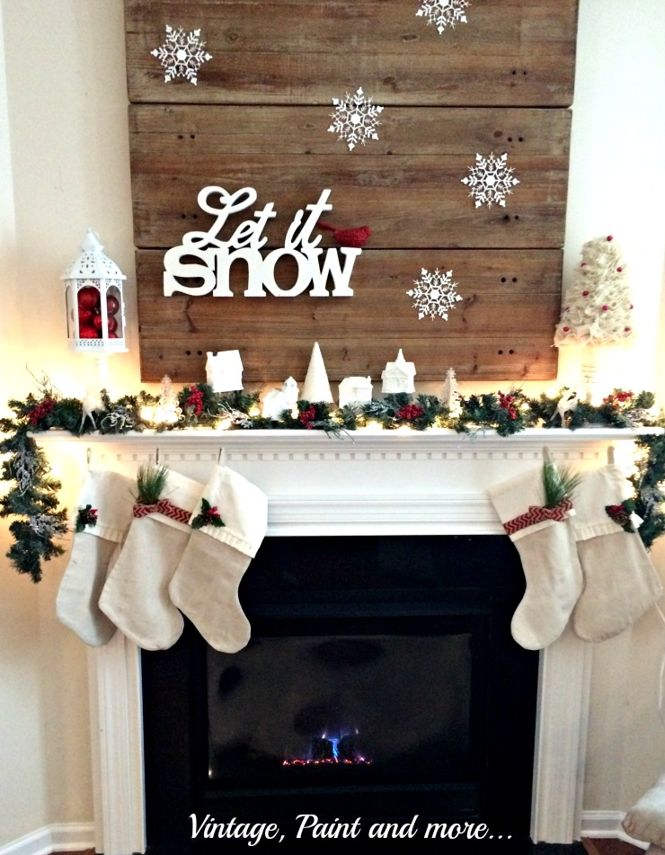 Vintage, Paint and more... snow themed mantel with white village, snowflakes and pops of red color in berries and ornaments along with drop cloth stockings